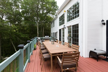 Brewster Cape Cod vacation rental - Back deck eating area