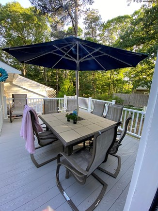 Yarmouth Port Cape Cod vacation rental - New deck with barbecue grill, table/chairs & new outdoor shower.