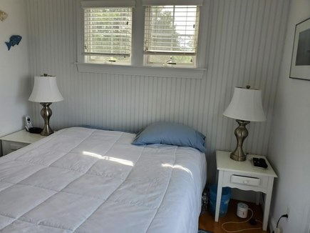 North Eastham Cape Cod vacation rental - Master bedroom with half bath, slider to deck