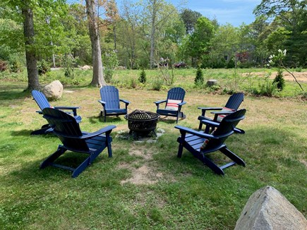 Brewster Cape Cod vacation rental - Fire pit to seat six in spacious backyard!