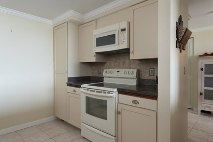 Harwich, Oceanfront Condo Cape Cod vacation rental - Kitchen with Microwave and stove