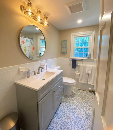Harwich Cape Cod vacation rental - Updated first-floor bathroom with shower/tub combination