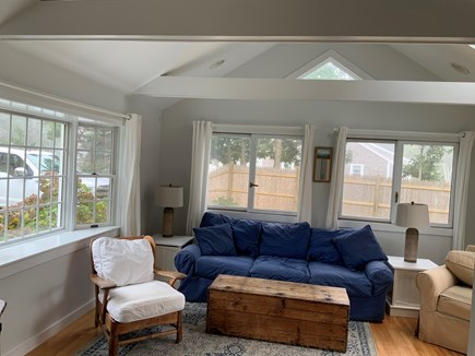 Harwichport Cape Cod vacation rental - Cathedral ceiling family room with sliders to deck.