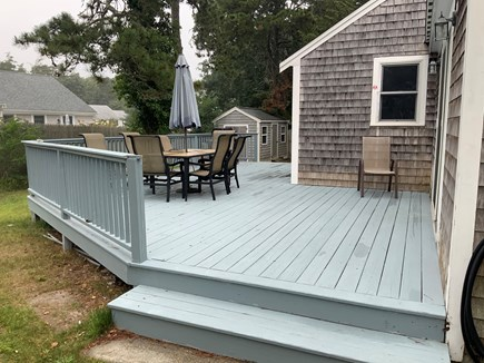 Harwichport Cape Cod vacation rental - Deck with grill, table and chair.