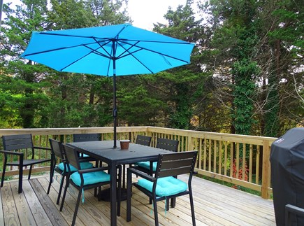 Eastham Cape Cod vacation rental - Deck area with grill -- overlooking quiet expansive backyard