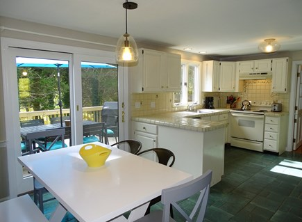 Eastham Cape Cod vacation rental - Fully equipped kitchen with separate dining area leading to deck
