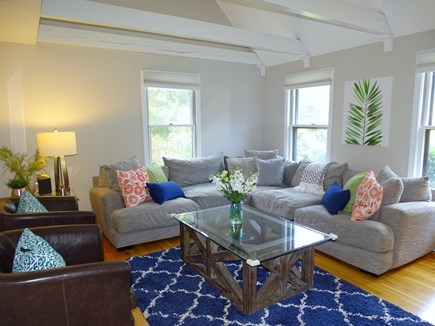 Eastham Cape Cod vacation rental - Bright vaulted living room with comfy sectional and flatscreen TV