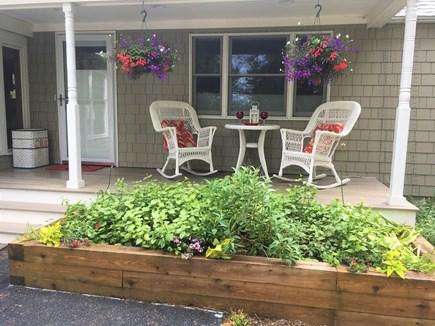 Harwich Port Cape Cod vacation rental - Front Farmers porch + Wicker Rockers + table