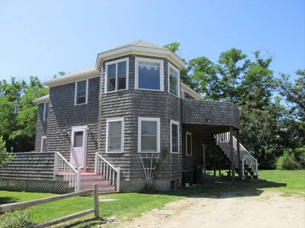 Brewster, Pineland Park Cape Cod vacation rental - Front view, large windows and deck face the bay