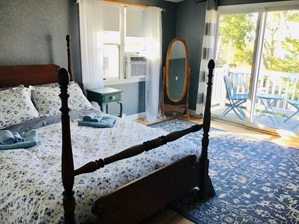 Harwich Cape Cod vacation rental - Master queen bedroom with beautiful garden and pond views