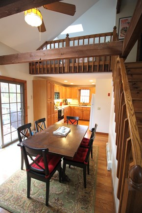 Eastham Cape Cod vacation rental - Dining Room with cathedral ceiling, loft above and kitchen beyond