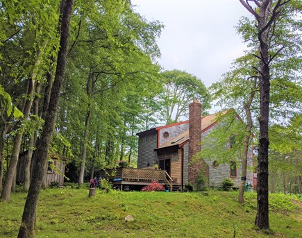 Eastham Cape Cod vacation rental - Lush, tree-lined grounds shown from back of house, w/double deck.