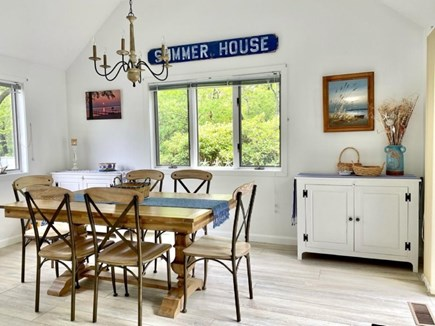 New Seabury, Pool Villa at the Mews Cape Cod vacation rental - Dining area with natural views of preservation area
