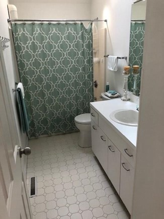 New Seabury, Pool Villa at the Mews Cape Cod vacation rental - First floor bathroom directly across from laundry room
