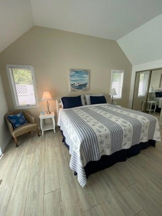 New Seabury, Pool Villa at the Mews Cape Cod vacation rental - Spacious master bedroom with a private slider to the pool