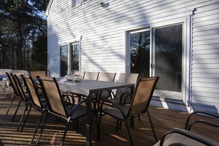 Eastham Cape Cod vacation rental - Dining table. Large Weber Genesis grill. String lights(not shown)