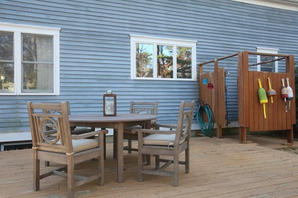 Eastham Cape Cod vacation rental - Seating group and outdoor shower on second deck