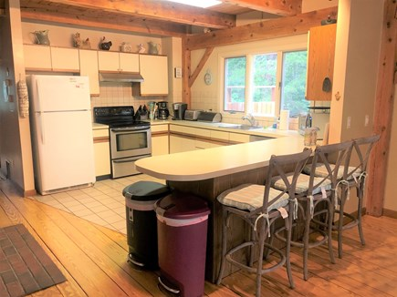 Eastham Cape Cod vacation rental - Fully stocked kitchen with bar stools