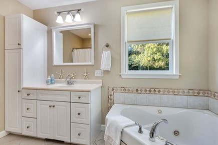 East Orleans Cape Cod vacation rental - Main bath with separate shower and whirlpool tub
