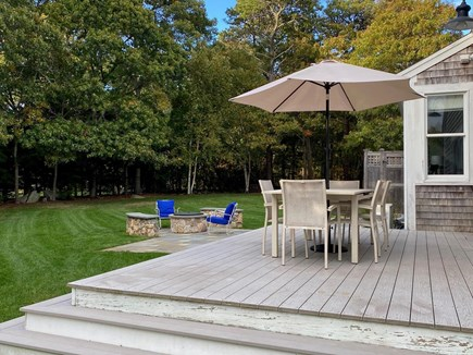East Orleans Cape Cod vacation rental - Deck looking toward yard and fire pit