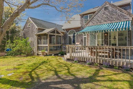 Eastham Cape Cod vacation rental - Large wrap around deck with two seating groups and Weber grill