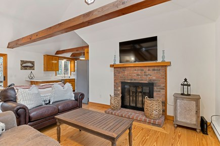 Eastham Cape Cod vacation rental - Cozy living rm with leather couches, wood brn fire pl & smart TV