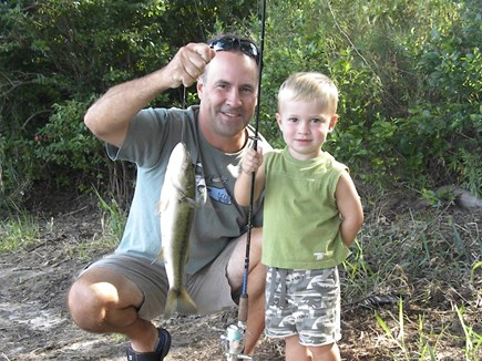 Falmouth, on Fresh pond Cape Cod vacation rental - Big freshwater basses in our pond.Little fisherman with a bass.