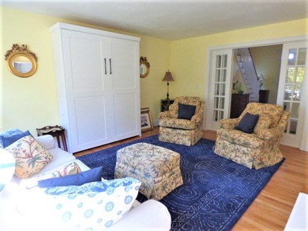 Harwich Cape Cod vacation rental - Family room with murphy bed, Doors can be closed for privacy