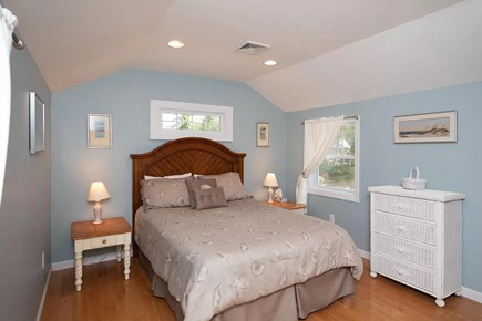 Eastham Cape Cod vacation rental - Bedroom #1 features a queen bed with storage and bedside outlets