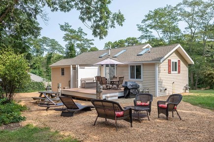 Eastham Cape Cod vacation rental - Ample seating in the private, wooded backyard