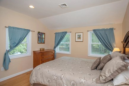 Eastham Cape Cod vacation rental - Bedroom #2 features a queen bed, closet, and beautiful views
