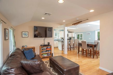 Eastham Cape Cod vacation rental - Living area with TV, games, two sofas, and more