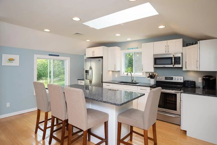Eastham Cape Cod vacation rental - Open kitchen with stainless steel appliances and ample seating
