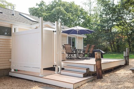 Eastham Cape Cod vacation rental - Outdoor shower and open air seating after morning beach trips