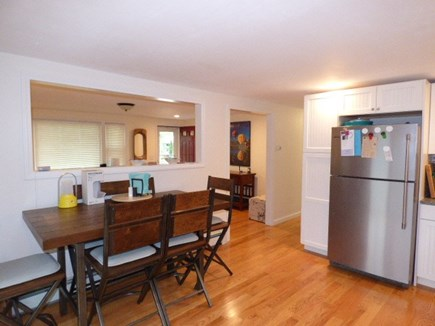 South Dennis Cape Cod vacation rental - Eat in kitchen with opening into living room