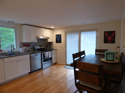 South Dennis Cape Cod vacation rental - Newly renovated Kitchen with sliders to the deck