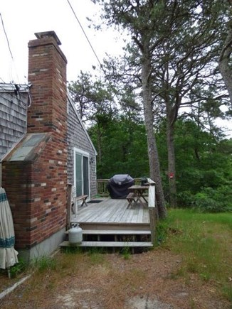 South Dennis Cape Cod vacation rental - Side deck off the the kitchen with gas grill