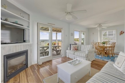 East Sandwich Cape Cod vacation rental - Bright living room with gas fireplace and magnificent views