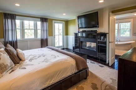 Provincetown Cape Cod vacation rental - Master king bedroom #1 with fireplace, shower and soaking tub,