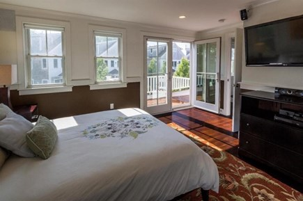 Provincetown Cape Cod vacation rental - 2nd floor guest bedroom with queen bed,  & balcony with bathroom