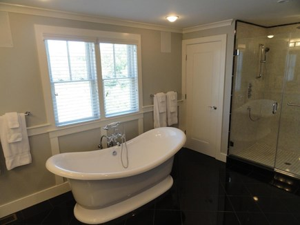 Provincetown Cape Cod vacation rental - Master bathroom #1 with soaking tub & shower