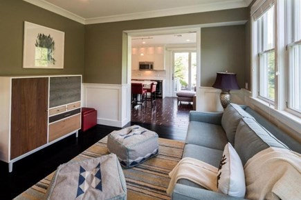 Provincetown Cape Cod vacation rental - Sitting room opens to living room with TV & fireplace