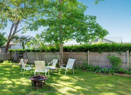 Falmouth Cape Cod vacation rental - Fire pit/backyard (there is also a grill & views of Little Pond)