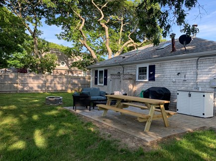 Falmouth Cape Cod vacation rental - Backyard space with gas grill, outdoor shower, large patio