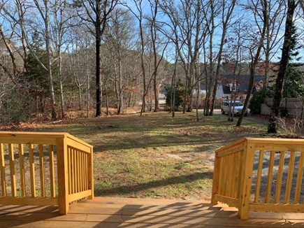 Wellfleet Cape Cod vacation rental - View from deck into expansive yard.