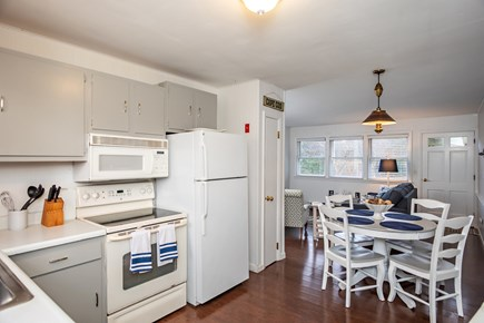 Dennis, Mayflower Beach Cape Cod vacation rental - Open kitchen and dining table on the right side