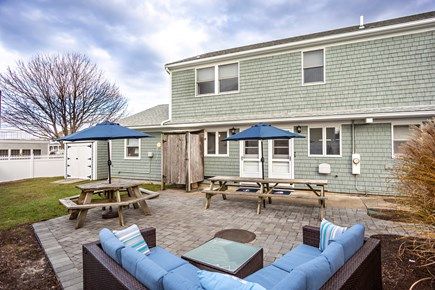 Dennis, Mayflower Beach Cape Cod vacation rental - Private backyard with plenty of seating, weber grill & shower