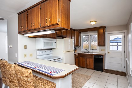 Dennis, Mayflower Beach Cape Cod vacation rental - Open kitchen with 3 stools at island-left side