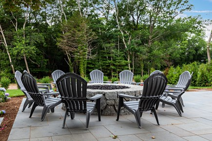 Dennis Village-Mayflower Beach Cape Cod vacation rental - Expansive back patio with gas fire pit & adirondack chairs