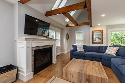 Dennis Village-Mayflower Beach Cape Cod vacation rental - Bright den with gas fireplace and TV with slider onto patio